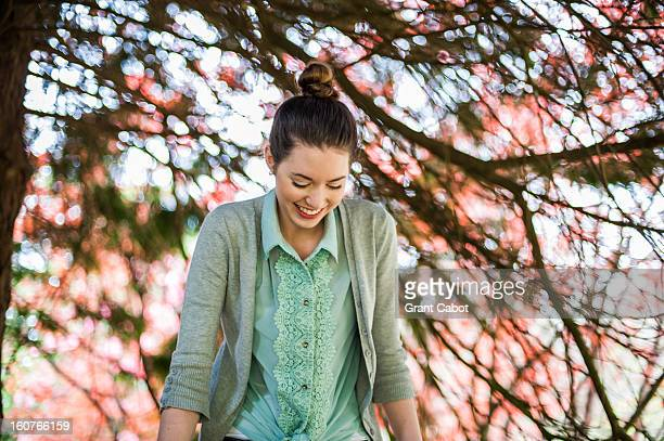 beautiful girl laughing in front of light pink flo - blouse stock pictures, royalty-free photos & images