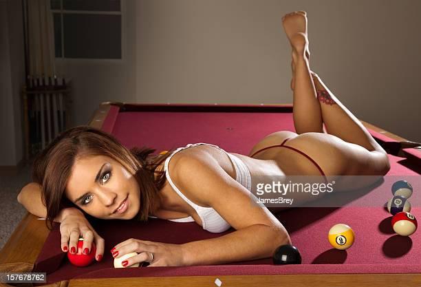 Beautiful Girl Laying on Billiards Table