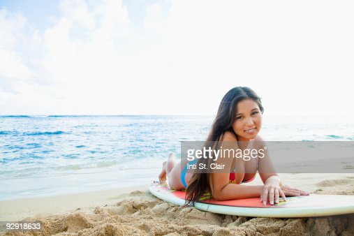 Beautiful Girl Laying On Surfboard At The Beach Stock ...