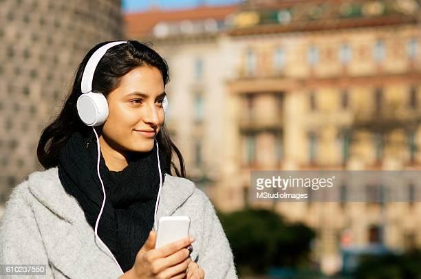 Beautiful girl listening music.