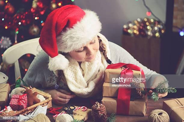 beautiful girl making Christmas presents