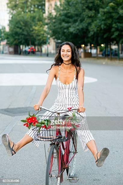 Beautiful girl on a bicycle.