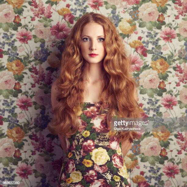 Beautiful girl on a floral background.