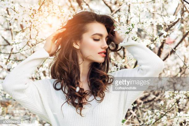 beautiful girl on the background of spring bush - long hair stock pictures, royalty-free photos & images