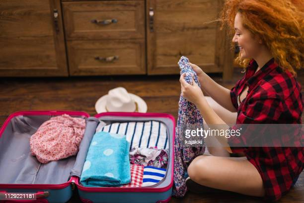 beautiful girl packing for a holiday at home - suitcase stock pictures, royalty-free photos & images
