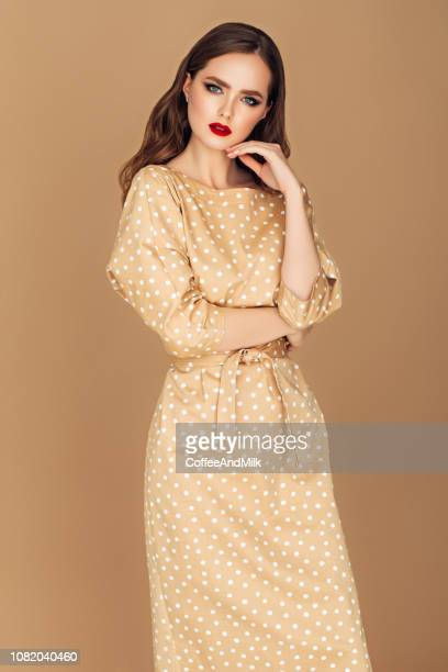 beautiful girl - beige dress stock pictures, royalty-free photos & images