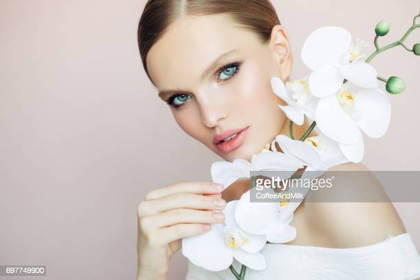 beautiful girl - orchid flower stock pictures, royalty-free photos & images