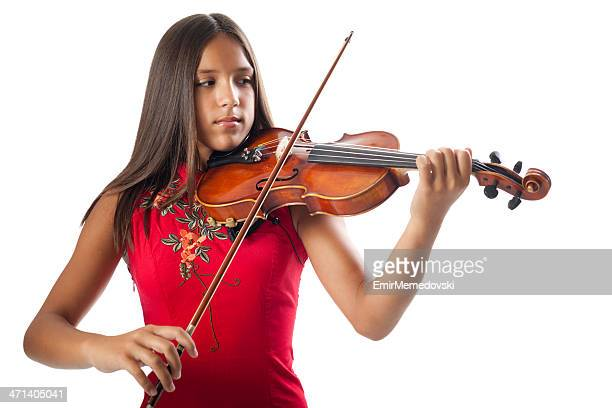 beautiful girl playing violin - soloist stock photos and pictures