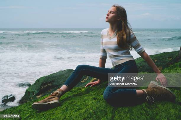 Beautiful girl posing on the ocean background