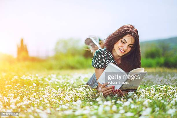 beautiful girl reading a book
