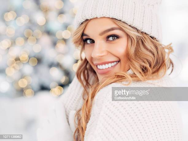 beautiful girl sitting near new year tree - smiling stock pictures, royalty-free photos & images