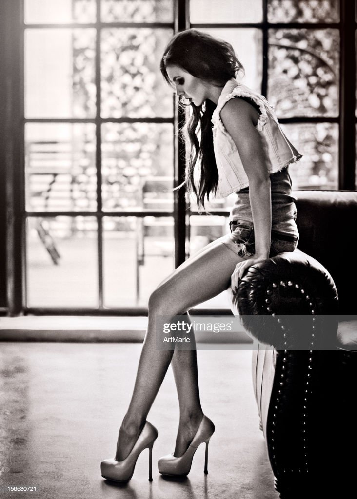 Beautiful girl sitting on a sofa : Stock Photo