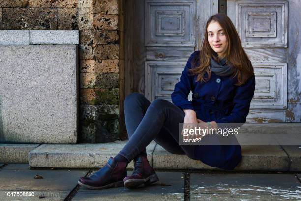 beautiful girl sitting - ankle boot stock pictures, royalty-free photos & images