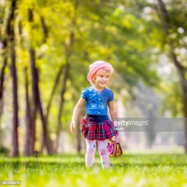 Beautiful girl standing in field