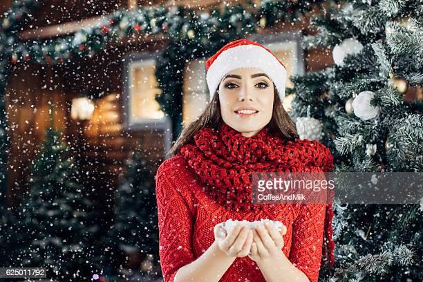 Beautiful girl standing near her house