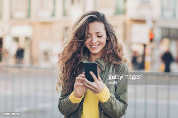 beautiful girl texting on the street - eastern european stock pictures, royalty-free photos & images
