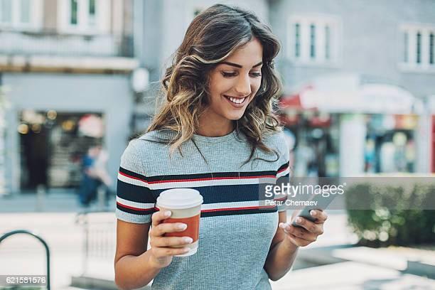 Beautiful girl texting outdoors
