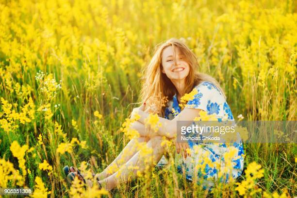Beautiful girl the flowers field summer sunset Healthy Lifestyle
