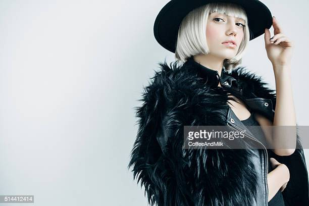 beautiful girl wearing hat - fur jacket stock pictures, royalty-free photos & images