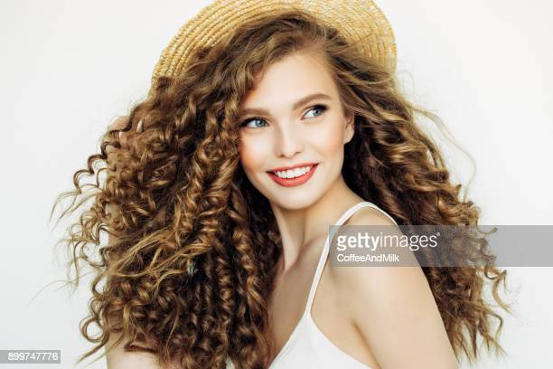 beautiful girl wearing hat - blond model long hair stock photos and pictures