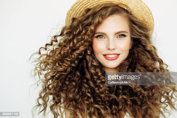beautiful girl wearing hat - curly hair stock pictures, royalty-free photos & images