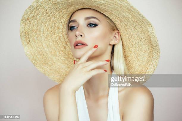 beautiful girl wearing hat - manicure stock pictures, royalty-free photos & images