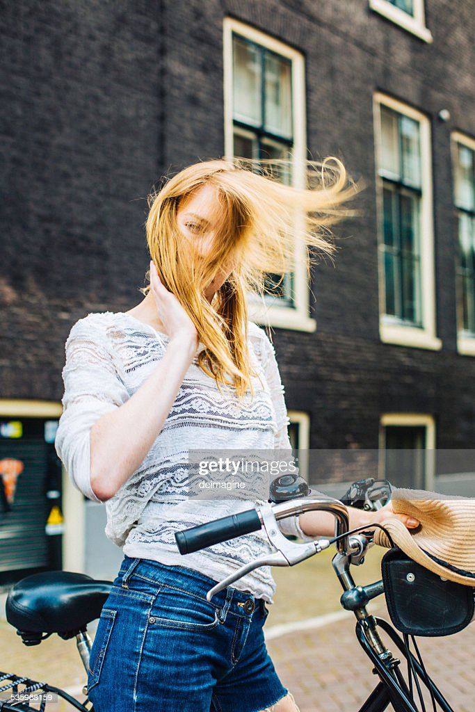 Beautiful girl with a bicycle. : Stock Photo