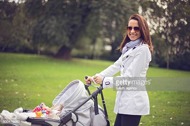 Beautiful girl with a stroller