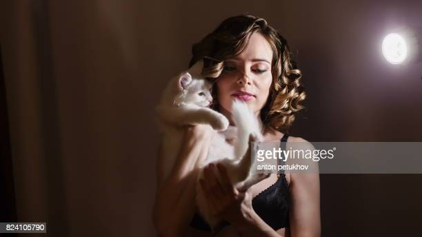 beautiful girl with a white fluffy cat in her arms. - female hairy arms stock photos and pictures