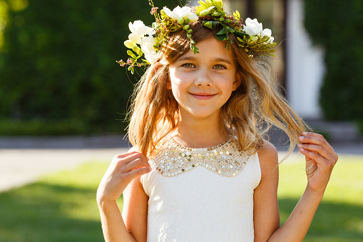 Beautiful girl with a wreath of fresh flowers 970739690