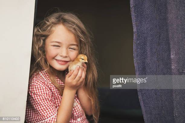 Beautiful girl with baby chicken
