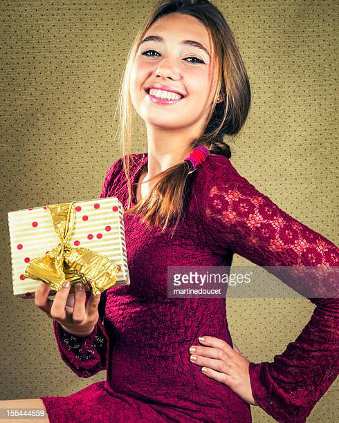 "beautiful girl with big smile holding a wrapped gift. - ""martine doucet"" or martinedoucet stock pictures, royalty-free photos & images"