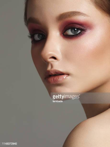 beautiful girl with bright make-up - stage make up stock pictures, royalty-free photos & images