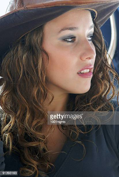 beautiful girl with cowboy hat - cowgirl hairstyles stock photos and pictures