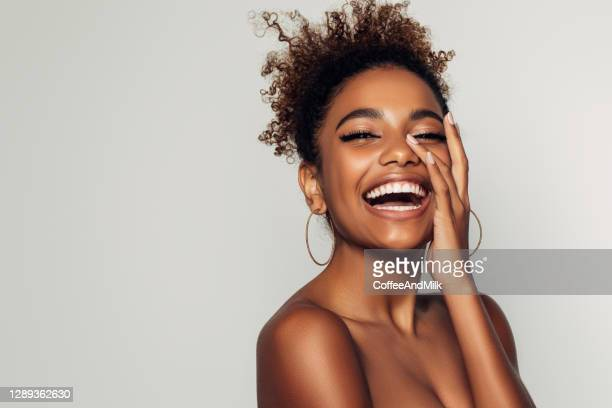 beautiful girl with curly hairstyle - african american ethnicity stock pictures, royalty-free photos & images