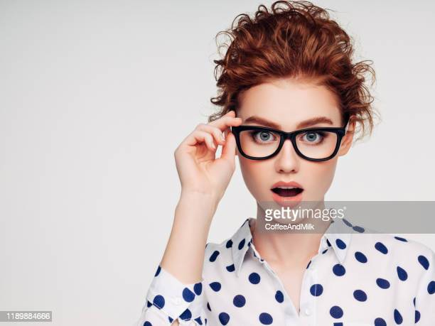beautiful girl with eyeglasses - spectacles stock pictures, royalty-free photos & images