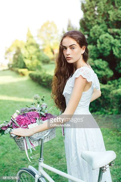 Beautiful girl with full basket of flowers
