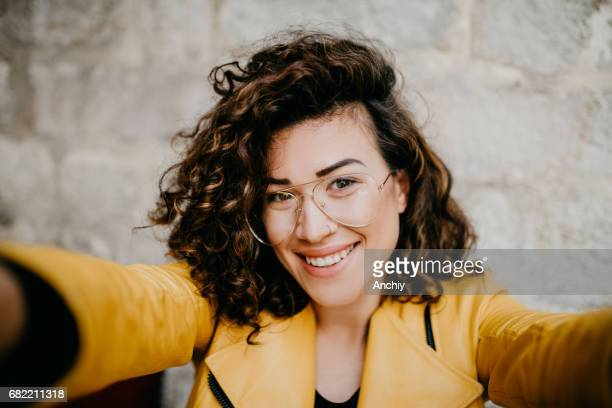 beautiful girl with glasses and nose ring is taking a selfie - curly stock pictures, royalty-free photos & images
