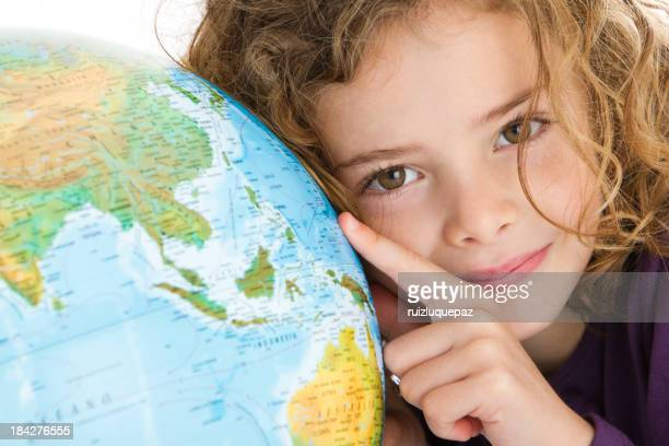 Beautiful girl with globe