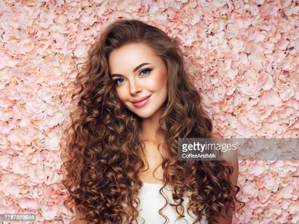 beautiful girl with long and curly hairs - pink dress stock pictures, royalty-free photos & images