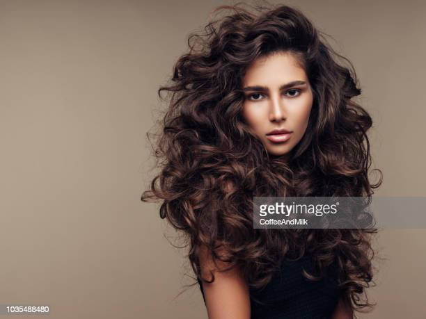beautiful girl with lush curly hairstyle - thick girls stock photos and pictures