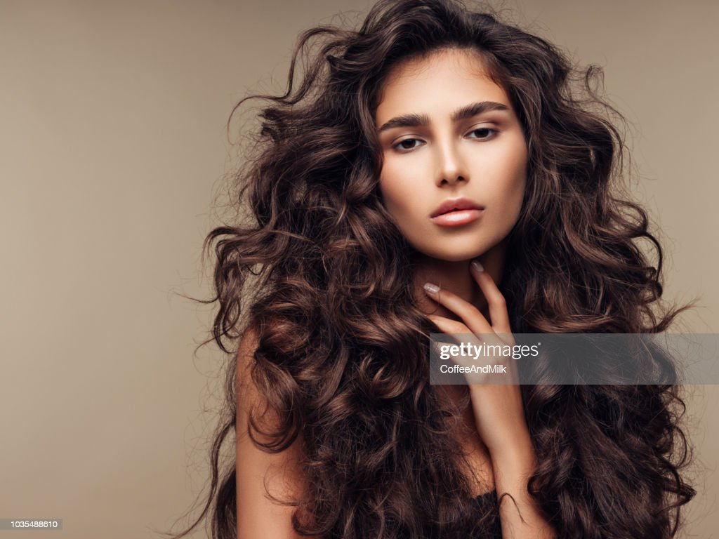 Beautiful girl with lush curly hairstyle : Stock Photo