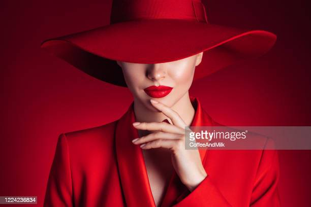 beautiful girl with make-up wearing red jacket and hat - mystery stock pictures, royalty-free photos & images