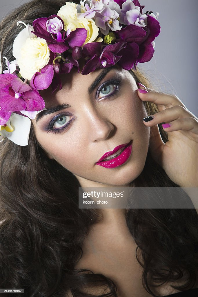 Beautiful girl with perfect skin and bright floral wreath on : Stock Photo