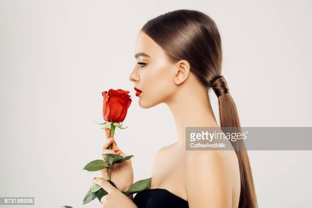 beautiful girl with red rose - red roses stock pictures, royalty-free photos & images