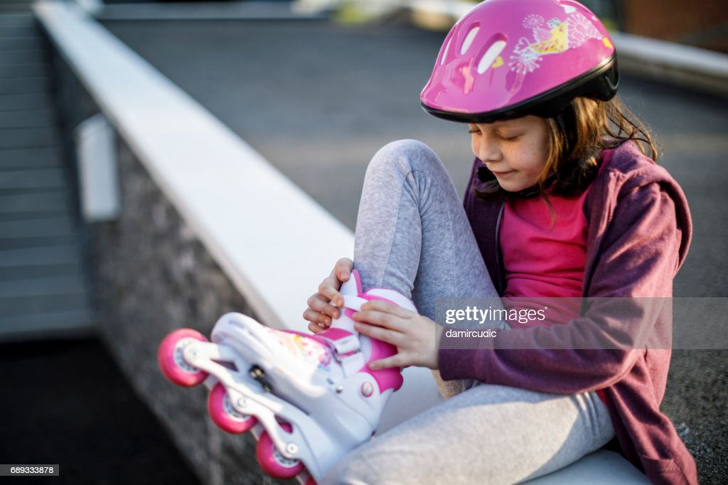 Beautiful girl with roller skates : Stock Photo