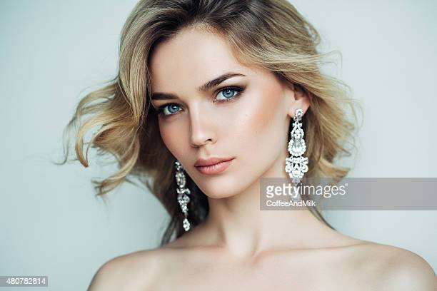 Beautiful girl with shiny earrings