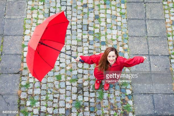 Beautiful girl with umbrella looking at camera