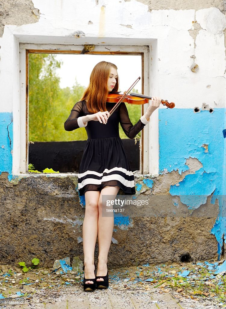 Beautiful girl with violin : Stock Photo