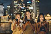beautiful girls are texting street night